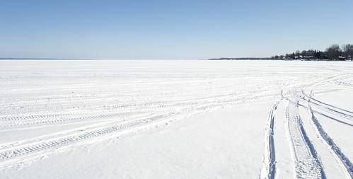 winter snow newyearsday frozen ice oneida lake sunny bright white boysenbay tracks snowmobile
