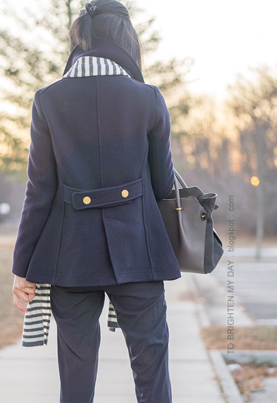 gray striped scarf, navy pea coat, navy trousers, gray tote
