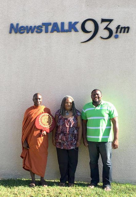 Bhante Buddharakkhita with 93fm Radio staff in Jamaica. Photo from Uganda Buddhist Centre – UBC Facebook