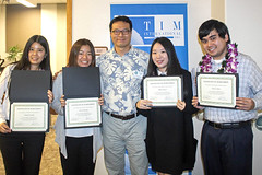Fall 2017 graduates celebrate with TIM Professor Junwook Chi at the school's Commencement Ceremony.