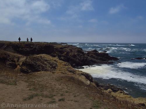 People on a clifftop near Glass Beach, California