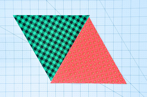 Pick 2 triangles - we want to sew them together with a quarter inch offset so the tips don't get cut off when sewing rows together!