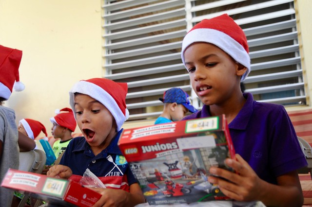 Coast Guardsmen deliver toys to children in Naguabo, Puerto Rico