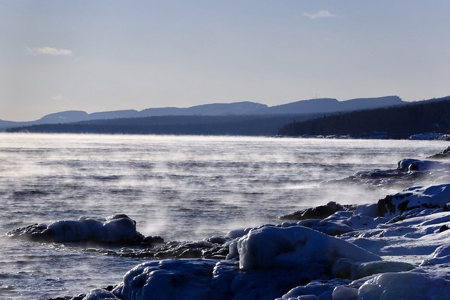 Steam fog on a winters day along the North Shore of Lake Superior, Minnesota.  The Sawtooth Mountains are in the background.