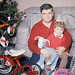 """Yay! My very first vehicle. Thanks, Santa! Dad holds me while mom takes the photo. His camera had no flash, so this Kodachrome slide was taken with really bright """"photoflood"""" lights that he also used in home movies. Milford Connecticut. Dec 25 1960 by wavz13"""