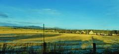 Kemnay across the fields with a glimpse of Bennachie in the background