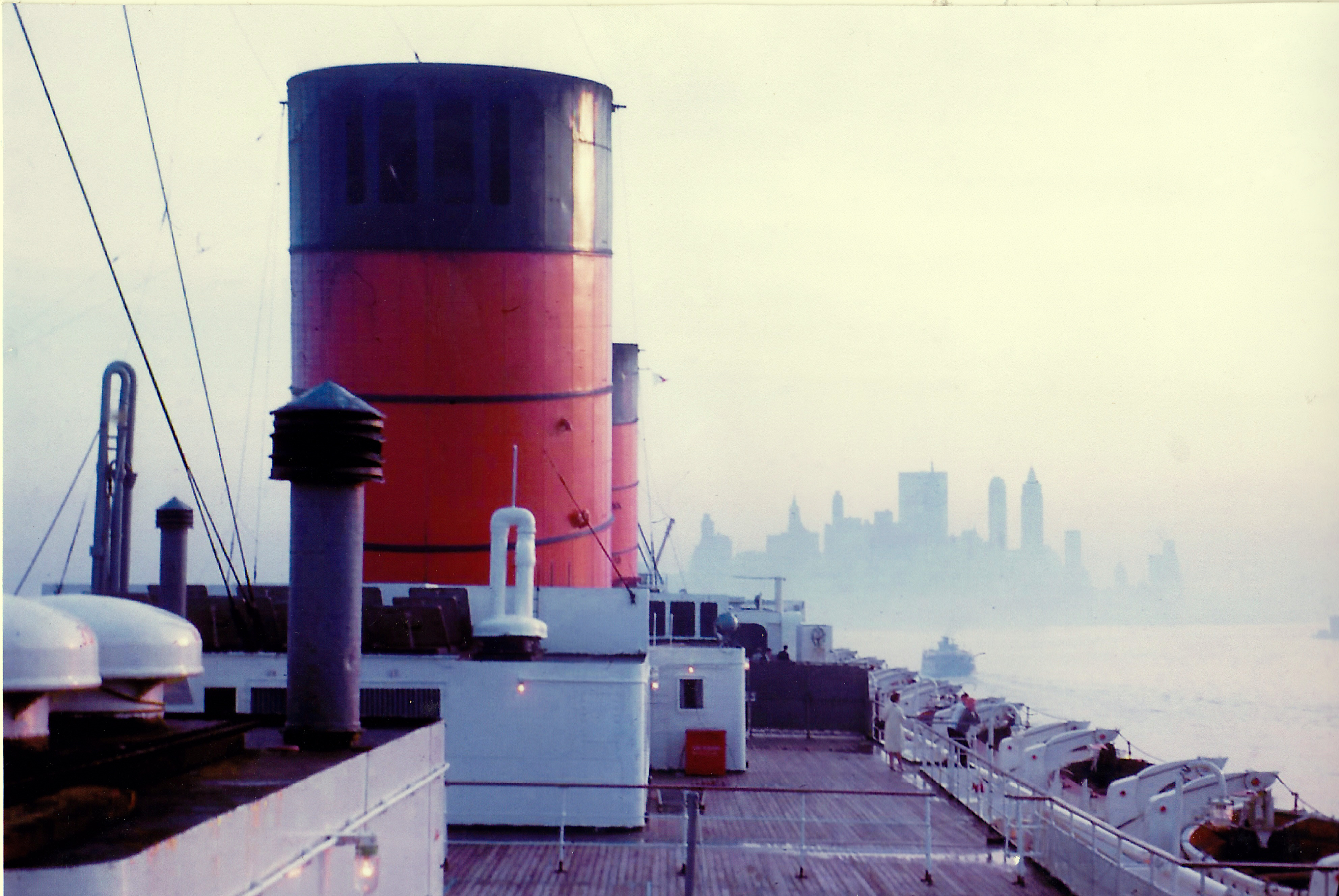 Queen Elizabeth entering New York harbor in 1965, taken from the boat deck, early morning