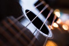 My ukulele lit by candlelight