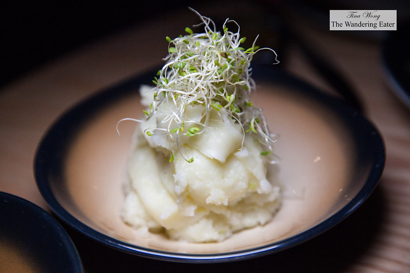 Mashed potatoes topped with sprouts