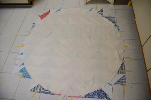 11. Quilt sandwich: Because I was low on backing/batting, I cut the batting to be slightly larger than the top. Instead of centering it, I could fussy-place it on top of the batting how it fits - smooth out!