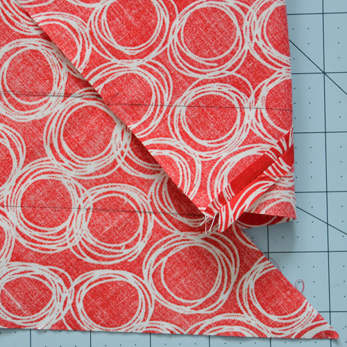 At the bottom left, the second line on the left should meet the first line on the right. Form a spiral around the fabric.