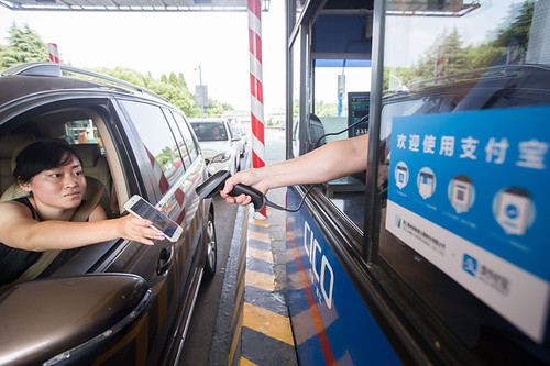 Paying toll by scanning SmartPhone