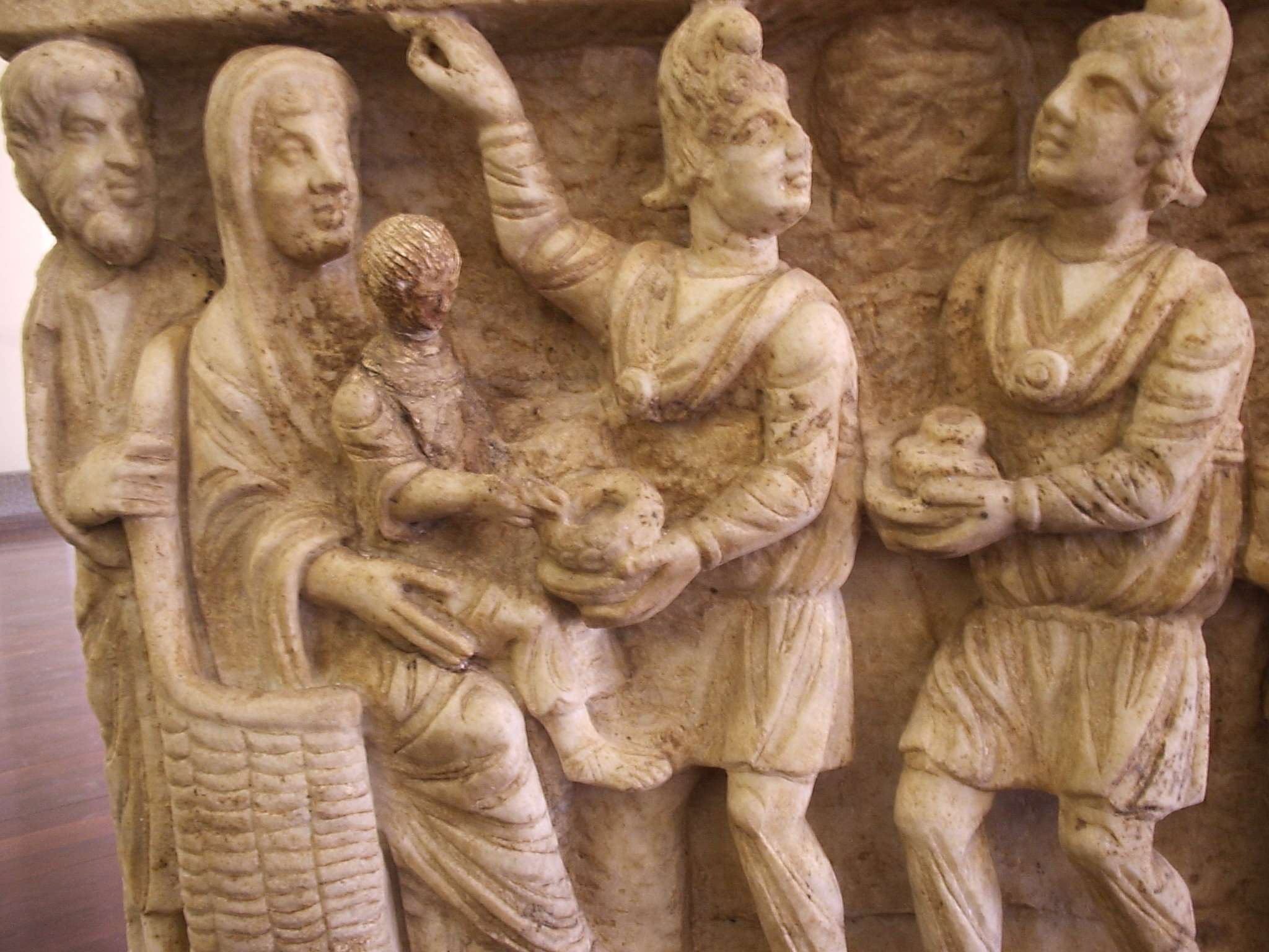 One of the earliest known depictions from a third-century sarcophagus (Vatican Museums). The clothing of the Magi here is typical of Parthian nobles.