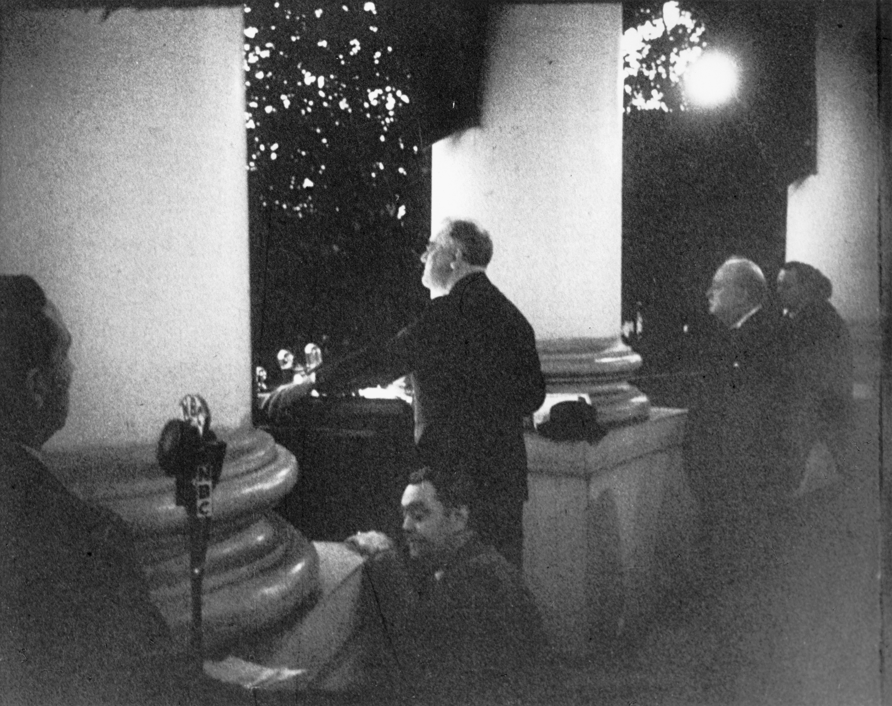 President Franklin D. Roosevelt speaks before lighting the 1941 National Christmas Tree. British Prime Minister Winston Churchill (right) was a surprise guest.