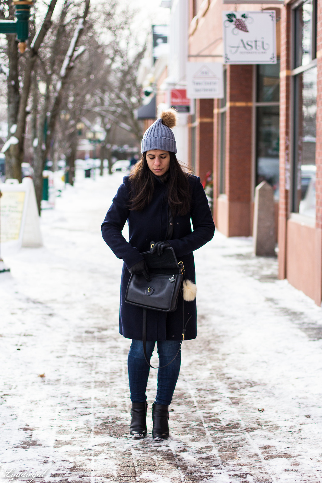 striped sweater, navy wool coat, pom pom hat, coach willis bag.jpg