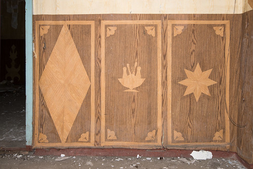 Wood imitation foil art in an abandoned Soviet army canteen. Chicken meat like shown in the middle frame were probably uncommon.