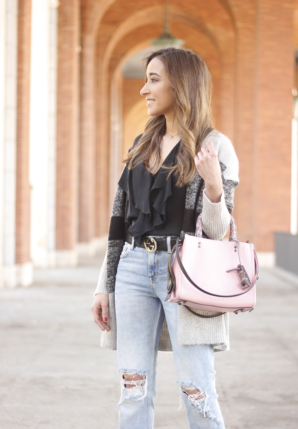 pink coach bag black heels ripped jeans inside cardigan casual winter outfit10