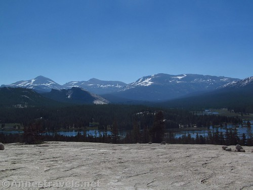 View from Pothole Dome: Mt. Dana, Lembert Done (in front), Mt. Gibbs, and Mammoth Mountain over the flooded Tuolumne Meadows in Yosemite National Park, California