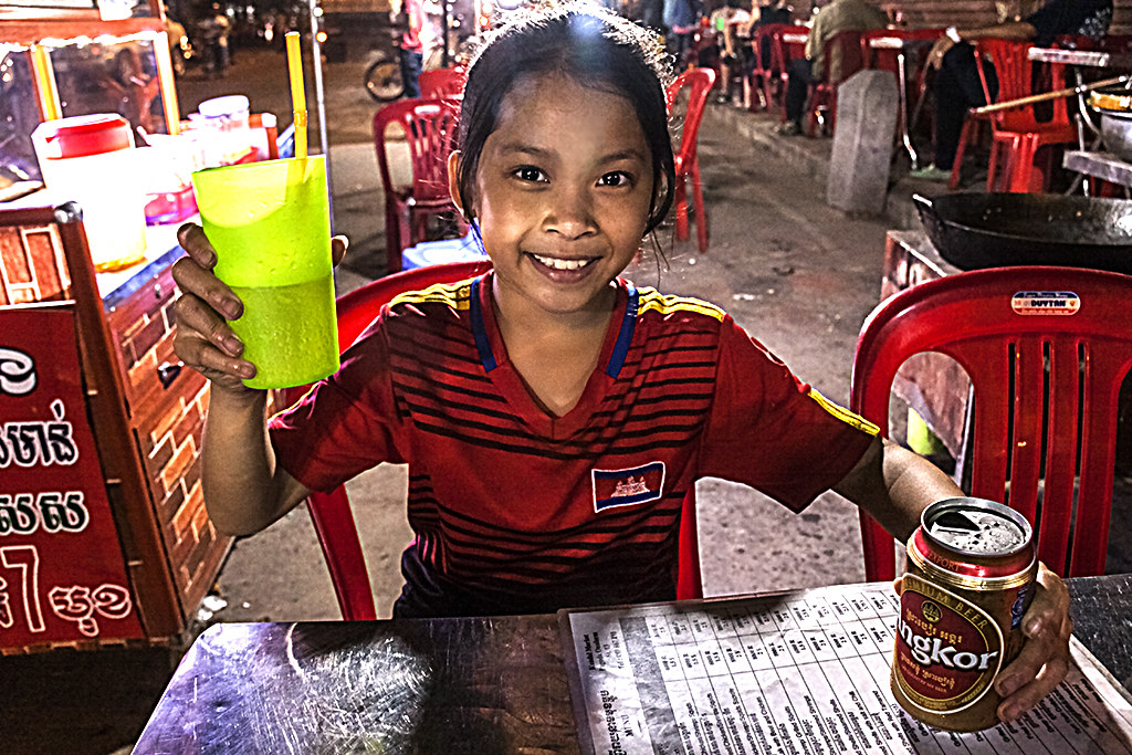 12-year-old waitress outside Wat Ounalom