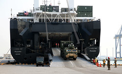 A military vehicle rolls off the ramp of USNS Pililaau (T-AK 304) during an offload of equipment in support of Cobra Gold 2018, Feb. 5. (U.S. Navy/Grady T. Fontana)