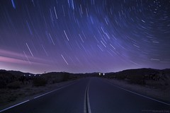 Star trails above road