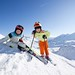 happy children in skiing outfit in snowy mountains, foto: Happysport
