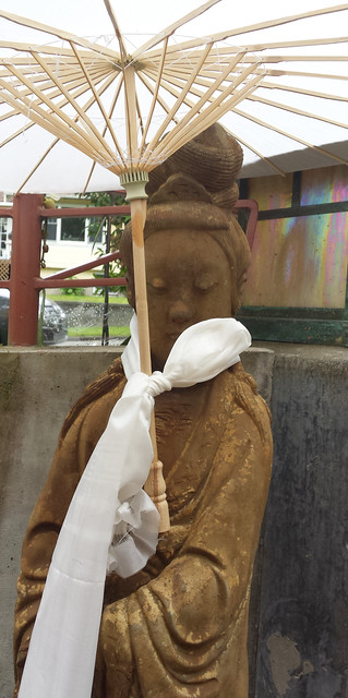 Lady Tara holding a white parasol, white khatag, His Holiness Dagchen Rinpoche's Memorial, courtyard, Sakya Monastery of Tibetan Buddhism, Seattle, Washington, USA