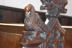 bench end: pelican plucking its breast (Henry Ringham, C1860)