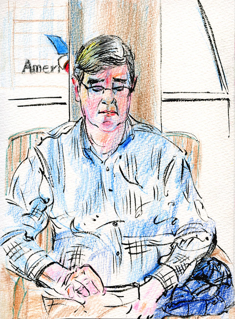 New York, JFK, David reading while waiting for flight home