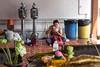 Man eating outside a Temple in Bangkok