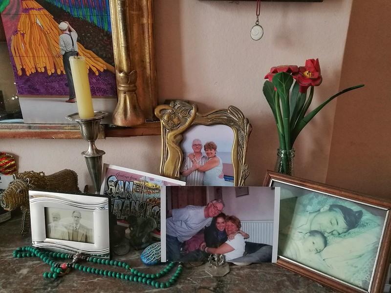 Flora's family photos on a shelf