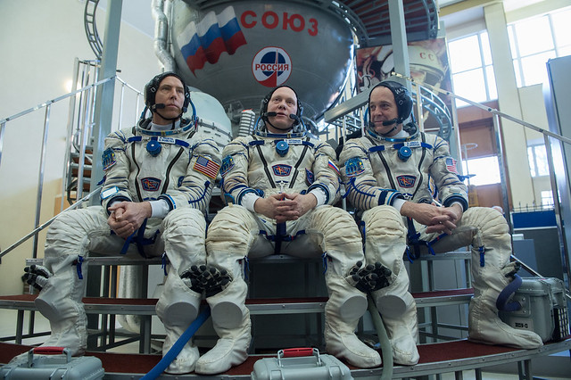 Expedition 55 crew members listen to reporters' questions