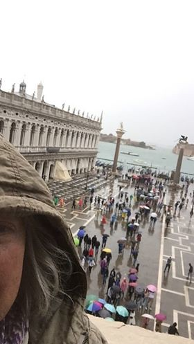 Me in Venice over looking Piazza San Marco. I just found some photos in messenger that I had sent to my son at the time. Oh ya it was raining.