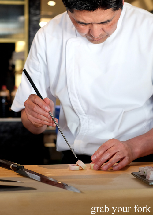 Chef Ryuichi Yoshii with a daikon sashimi roll at Fujisaki by Lotus at Barangaroo in Sydney