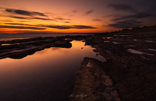 bulb longexposure rockformations sunset clouds rocks seascape sky