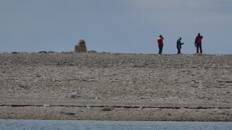 Neighbors ashore with cairn