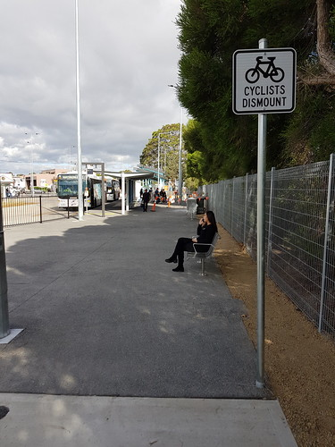 "A sure sign of a poorly designed bike path, the ""cyclists dismount"" sign"
