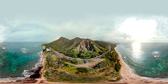 Diamond Head Crater ( Leahi), the Diamond Head Lighthouse and the Diamond Head Road as seen from 315 feet above Kuulei Cliffs Beach - an aerial 360° Equirectangular VR