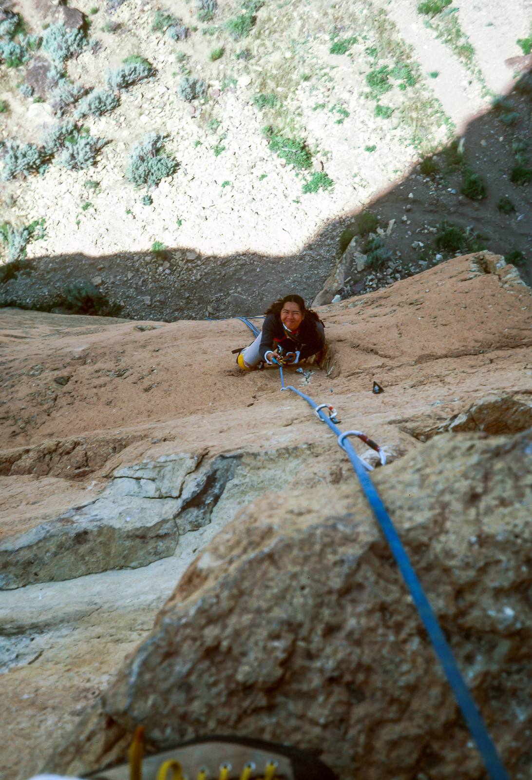 Faye cleaning the first pitch on the west face of Monkey Face