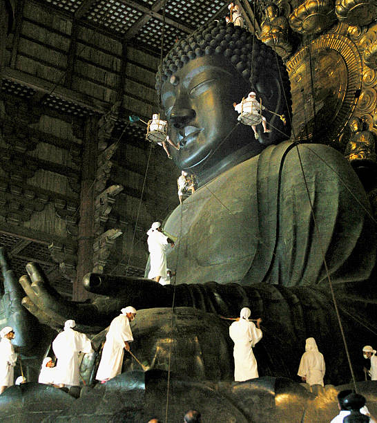 Cleaning gets underway on the 15-meter-high giant statue of Buddha of Todaiji Temple on August 7, 2004 in Nara, Japan. The Buddha, which was completed in AD 751, is being spruced up ahead the Buddhist festival period called bon. From gettyimages.com