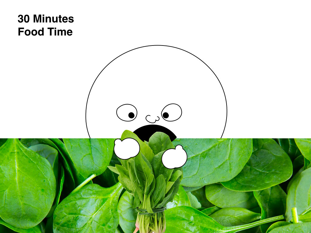 a giant cartoon head eating spinach