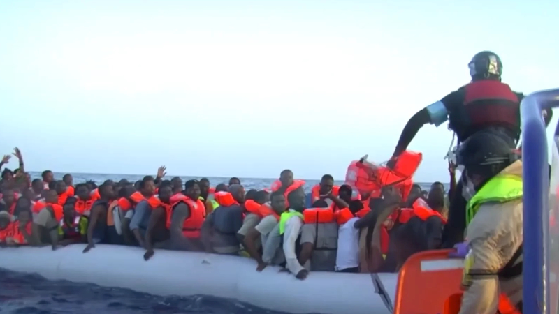 A boat filled with immigrants on the sea