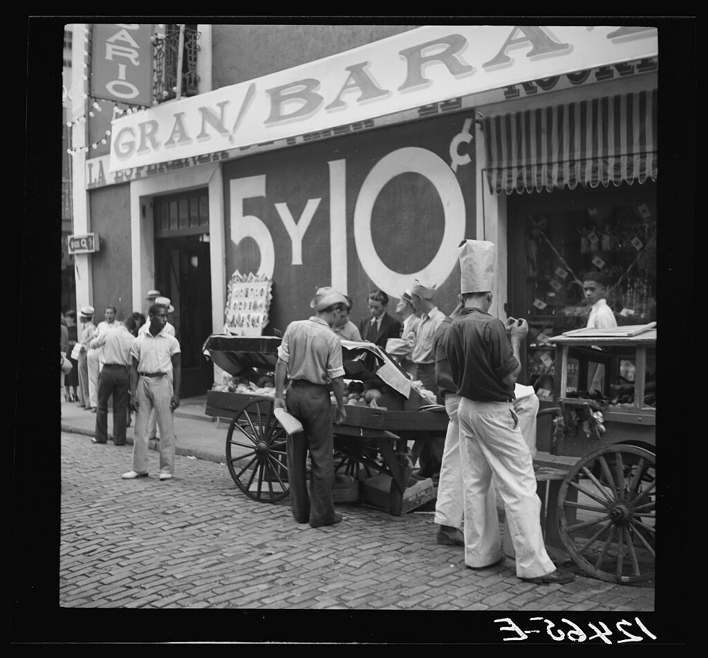 Pushcart vendors in front of a five and ten store. San Juan, Puerto Rico (LOC)