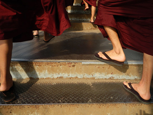 Buddhist monks climbing stairs in Yangon, Myanmar