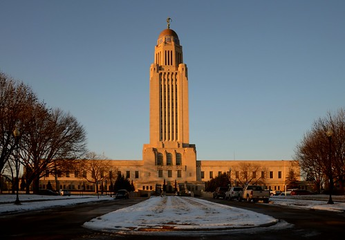 lincoln nebraska building capitol downtown architecture sunset gold america power politics snow cold winter evening lane tower planes midwest