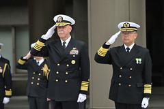 Adm. Scott Swift and Adm. Yutaka Murakawa, Japan Maritime Self-Defense Force chief of staff, salute during an honors ceremony at the Japan Ministry of Defense, March 6. (Japan Maritime Self-Defense Force)