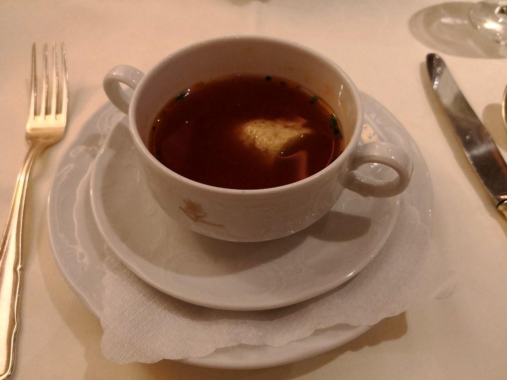 Tomato consommé with basil dumpling