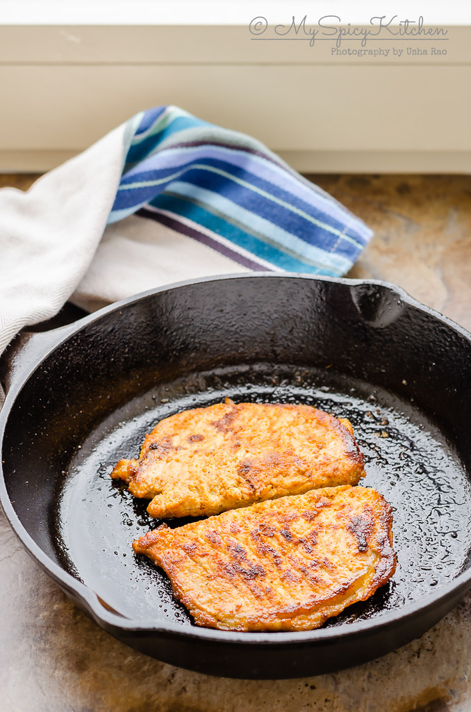 Cooked 3 ingredient Pork chops in a cast iron pan