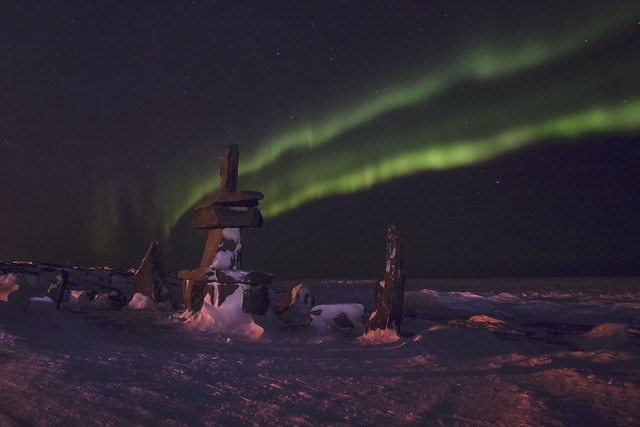 inukshuk with aurora