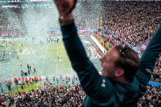 An Eagles fan celebrates as confetti falls on the field at Super Bowl LII, Minneapolis MN